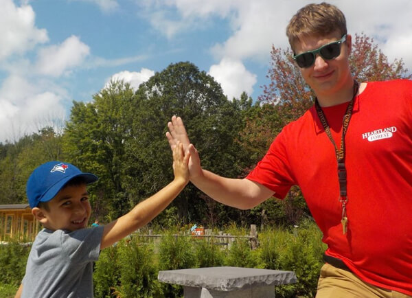 Camp Counsellor and boy high five
